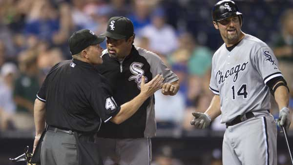 Chicago White Sox manager Ozzie Guillen argues a call with home plate umpire Jerry Meals &#40;41&#41; as Chicago White Sox&#39;s Paul Konerko &#40;14&#41; looks on during the ninth inning of a baseball game Wednesday, July 20, 2011 in Kansas City, Mo. <span class=meta>(AP Photo&#47;Reed Hoffmann)</span>